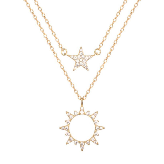 Double layered sun and star pendant necklace with diamonds in 925 sterling silver